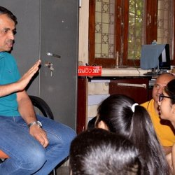 Prof. Shashidhara responding to children during their meeting